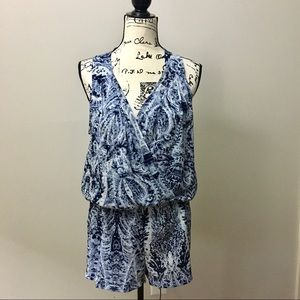 BCBGMaxAzria sleeveless wrap top romper. Blue